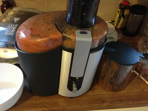 Juicer with debris from juicing
