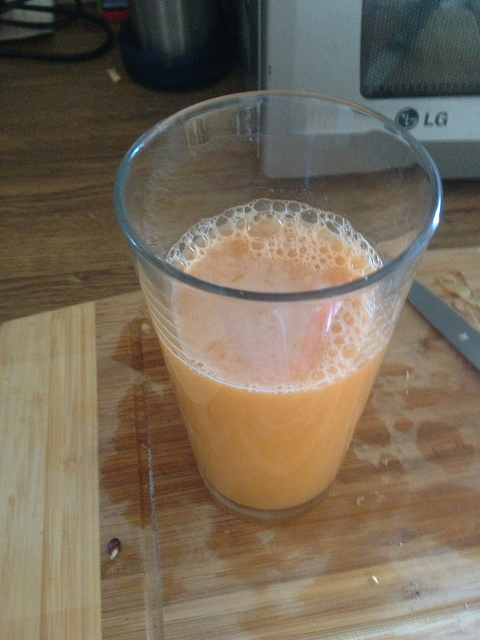 Carrot, pineapple, apple and fresh ginger root juice