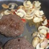 Fresh burgers with mushrooms, shallots, chilli and garlic