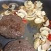 Fresh burgers with mushrooms, shallots, chilli and garlic