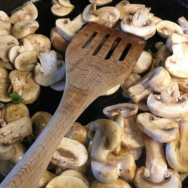Cooking mushrooms in an iron skillet. Mushrooms are low carb and sauteing them in butter is compatible with the keto diet