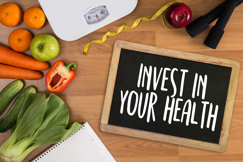 Invest in your health Healthy lifestyle concept with diet and fitness Get fit in 2017 fitness equipment and healthy food