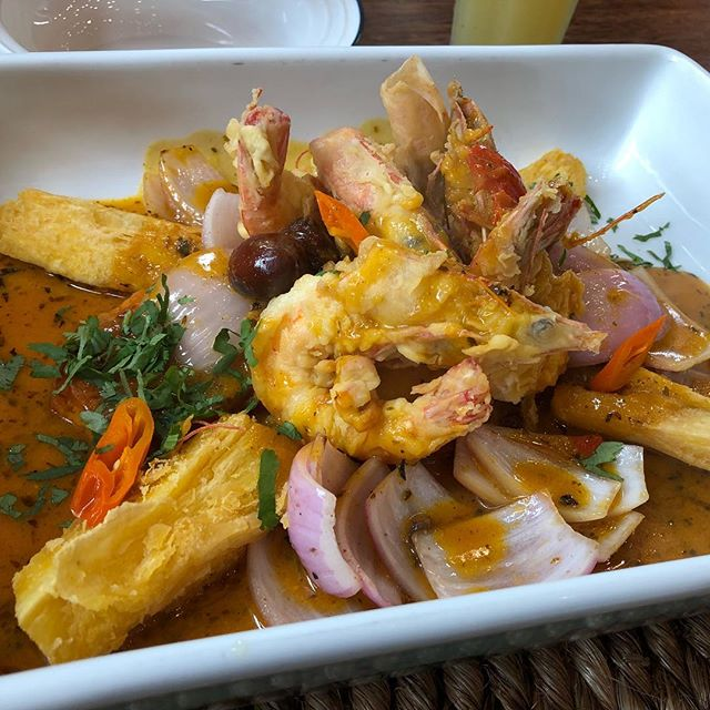 causa norteña - seafood with potatoes and onion in a rich sauce