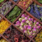 Assortment of dry herbs tea in wooden box.
